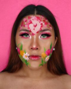 dramatic pink makeup look with tulips and hearts on face