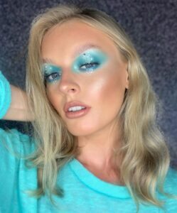 blue eyeshadow look with face gems